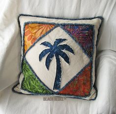 """Quilted patchwork palm tree boho pillow cover, with navy, greens and orange batik and natural denim 18"""" on Etsy, $48.00"""