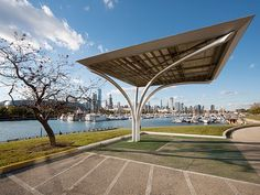 Solar Canopy. Thornton Tomasetti provided structural engineering and steel detailing for an award-winning 11-foot-tall solar canopy / EV dock consisting of 6,000 pounds of architecturally exposed structural steel. The prototype structure, designed to harvest solar energy to power electric / hybrid vehicles, is composed of a tree-like steel superstructure that can support up to 900 pounds of solar equipment, a 300-square-foot canopy featuring photovoltaic panels, and a subterranean ...