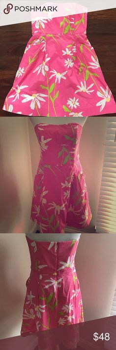 Lilly Pulitzer Strapless Pink Dress Beautiful dress from Lilly Pulitzer in pink with white and green flowers. Great condition. Has pockets! Lilly Pulitzer Dresses Mini