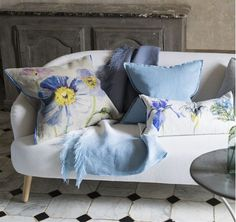 Adding a throw or cushion will instantly update your sofa - here the Papaver cushion and Saraille linen throw bring linen textural detail to make an inviting space.