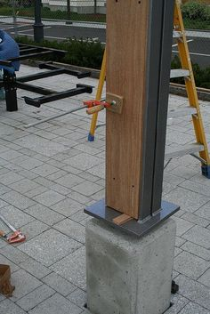 Concrete base @ wood and steel angle column by gap123, via Flickr: