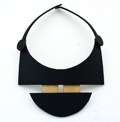 Minimal geometric black and gold necklace. €20.00, via Etsy.