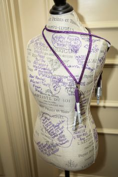 A Bat Mitzvah Sign-In board using a mannequin form is great for a fashion theme