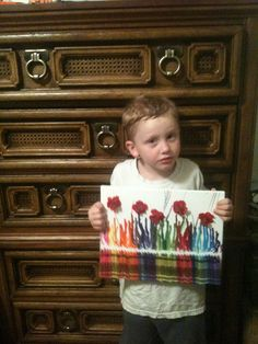 My grandson showing off his crayon art.