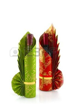 Luxury wrapped bottles wine for christmas in red and green Stock Photo