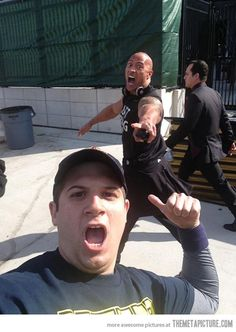The Rock photobombing a fan…