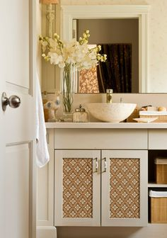 OK, really - I have to stop looking at these stencils! But this bathroom is so lovely. And the stenciled cabinet is a great idea for a patterned punch in a small space.