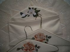 Cover wire clothes hanger with muslin and painted a flower.