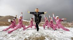 A group of women practise the ancient Chinese sport of wushu.