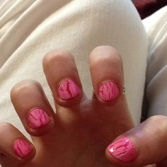 Hot pink nail polish with white crackel nail polish over it! Easy and cute :)