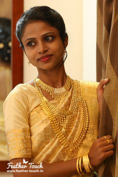 Adorable bride with beautiful eyes in golden saree.