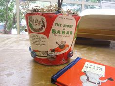 """Third place winner in the Adult division for our 2013 UNBOUND Book Art & Craft Contest - Ruth Terashima's """"Babar Themed Plant Pot.""""  Created from recycled gift wrap, book pages and glass gems.  Book used: """"The Story of Babar"""""""