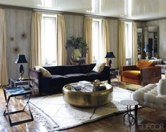 living room- eclectic, rich jewel tones in a creamy backdrop