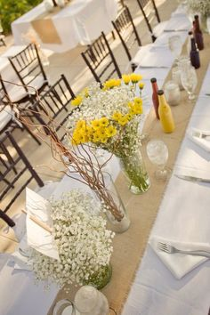 Wedding: burlap table runner. Babies breath and daisy centerpieces. DIY ketchup and mustard bottles.