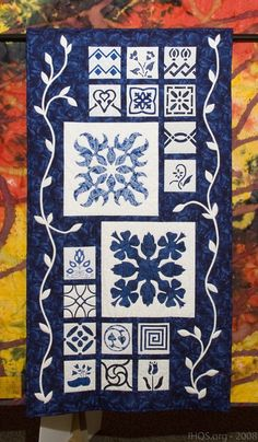 """Blue Hawaii"" by Carole Meyer, 3rd place, 2008 Indiana Heritage Quilt Show. 4″ reverse appliqué patterns taken from a book ""Dutch Treat"" by Judy Garden"