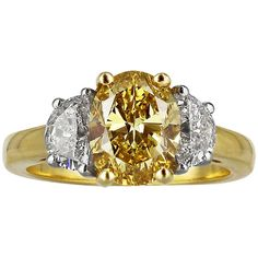 2.04 Carat Oval Shaped Canary Diamond Three Stone Ring | From a unique collection of vintage engagement rings at http://www.1stdibs.com/jewelry/rings/engagement-rings/