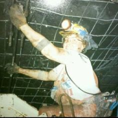 """Me roofbolting in the coal mine."" Same lovely woman from other pics.. Not only is she running a roof bolter (a fast paced physically demanding job) but she is smiling and doing it happily.. I know a few whiny 20 something's that could learn a thing or two from her.."