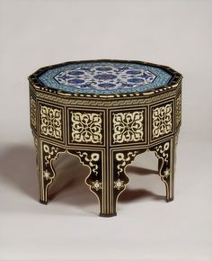 Table Place of origin: Iznik, Turkey (made) Istanbul, Turkey (made) Date: ca. 1560 (made) Artist/Maker: Unknown (production) Materials and Techniques: Wood, inlaid with ebony and mother of pearl; with fritware ceramic top, painted under the glaze Moroccan Table, Moroccan Decor, Oriental Furniture, Antique Furniture, Turkish Furniture, Classic Furniture, Arabesque, Turkish Art, Moroccan Design