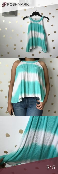 Ombre Halter Flowy Top Ombre Asymmetrical Halter Flowy Top This top is super cute!  Has a halter neckline, very flowy and zipper on the back.  Size is a large, it is big on me.  Perfect for spring/summer and any festival! les amis Tops Tank Tops