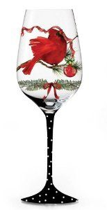 """A Peaceful Christmas Glass by Evergreen Enterprises, Inc. $13.49. Hand wash only.. Multi-colored. Hand painted wine glass. Original design by © Nancy E. Mink. Licensed by Persostence of Vision, Ltd.. 3.5""""W x 9""""H. eady to help decorate for Christmas, this bright red cardinal clutches an ornament in its beak as he perches on an evergreen bough. He is the image of the season, while below him the polka dotted stem and base of this glass add a touch of whimsy to any moment...."""