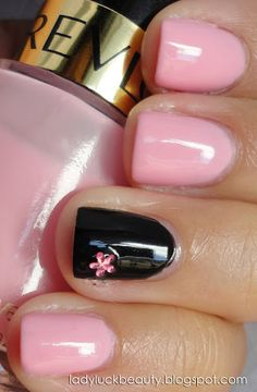 Pretty nails. I like the pink color and the pink flower on the black nail.