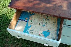 vintage maps as drawer liners.  love!  cool if you have glass doors on the cabinet so you can see them all the time!  Or do it on the back of a bookcase.