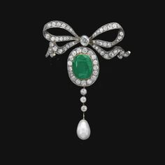 NATURAL PEARL, EMERALD AND DIAMOND BROOCH, LATE 19TH CENTURY. The surmount of ribbon design, suspending a cushion-shaped emerald and natural pearl drop, millegrain-set with circular-cut and cushion-shaped diamonds, French import marks, brooch fitting detachable.