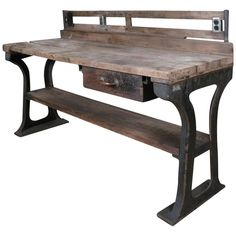 View this item and discover similar for sale at - A very nice antique workbench island with bold cast iron bases and thick wide plank wood top. also has a removable backstop with cast iron supports Vintage Industrial Furniture, Funky Furniture, Recycled Furniture, Classic Furniture, Modern Industrial, Kitchen Furniture, Rustic Furniture, Table Furniture, Furniture Stores