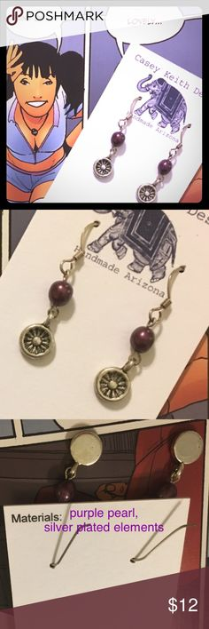 Purple Pearl Earrings Outrageous Purple pearl dangles with a demure starburst on silver plated earwire. Dainty & fun to wear while injecting the  dose of purple you have been craving.  Purchase includes Artists signature gift packaging. Casey Keith Design Jewelry Earrings
