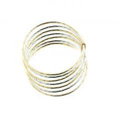 Bracciale oro bianco e giallo.    A sette file, senza apertura.    Diamantato.    Diametro cerchio 6.5 CM.    Lavorazione artigianale.Creazione e produzione Made in Italy.