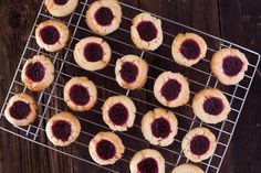 Emeril's Raspberry Lemon Thumbprint Cookies - If you chill the dough for just a bit in the frig, it's much easier to handle.  http://www.food.com/recipe/emerils-raspberry-lemon-thumbprint-cookies-221282