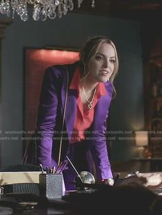 Fallon's red bell sleeve blouse and purple suit on Dynasty