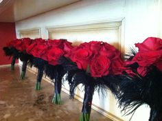 Great contrast, red & black. A great way to incorporate black into your wedding.  Petals by Design (Laura)