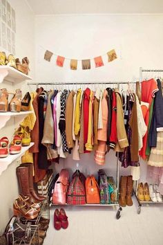 Ways to Store Your Stuff When You Don't Have a Closet: Clothing racks at different heights