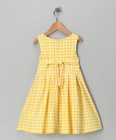 A sunny color, a peppering of pleats and an easy-on back zipper combine to make one perfect playtime piece. With a swing silhouette and a crisp white bow, this dress is so sweet there's no need for dessert.