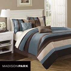 @Overstock - This Boulder Stripe comforter set from Madison Park is made from piecing together the highest quality microsuede to create super soft feel.  This 7-piece bedding set features shades of blue, ivory and brown.  http://www.overstock.com/Bedding-Bath/Madison-Park-Boulder-Stripe-7-piece-Queen-size-Comforter-Set/5480031/product.html?CID=214117 $102.04