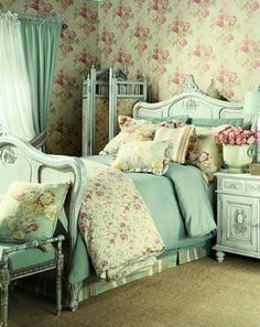 Love the bed and the blue accents (but not a fan of the floor/wallpaper)