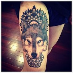 I like this Wolf Tattoo... but i can do without the design under the wolfs head