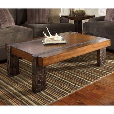 With a unique rustic design that is sure to transform the atmosphere of any room, the Brockland Cocktail Table features a medium brown finish perfectly complemented with the block wood mosaic accents in natural mixed colors.