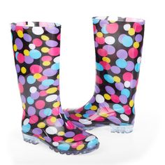 Have fun in the rain! Our stylishly practical rain wellies are updated with colorful polka dots. Rubber outer will keep feet dry. Nylex lining allows easy foot entrance into the boot. Slip resistant tread on bottoms for sure footing in inclement weather.