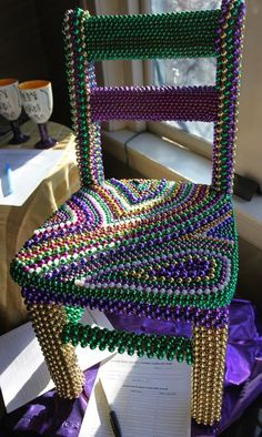 Mardi Gras chair. Isn't this the coolest??? Image via Asheville Mardi Gras on facebook.