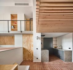 The cradle-like mezzanine is made of slatted wood that allows light to filter down onto the ground floor dining area. This space adjoins a recessed kitchen, while a bathroom is tucked away behind a wooden door panel. Arched Windows, Windows And Doors, Gaudi, Best Interior, Interior Design, Modern Interior, Concrete Retaining Walls, Barcelona Apartment, Wooden Steps
