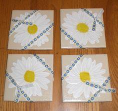 Daisies on an oatmeal tile.