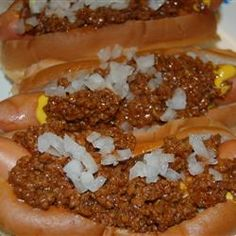 Grandpa's Classic Coney Sauce Recipe ~ Ground beef is simmered in a tangy sauce with onion. My Grandfather owned a drive-in restaurant back in the 1950's. This is his exact recipe for Coney Dogs from back in the day, it is always hit with friends and family!