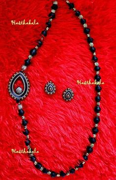 Gold and Black side pendent necklace. This necklace is made of black paper beads and golden acrylic beads with teardrop shaped paper pendent on www.facebook.com/hasthakala2014