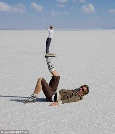 Artist: Daily mail reporter Title: Salar de Uyuni Material: Picture The artist has chosen to display these two women in very different lights. One is on bottom and one is on top. Maybe they are sisters and they can be supported by each other.