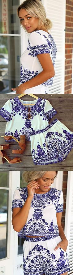 Adorable 2-piece set in a chic blue & white Porcelain floral print features crop top with crew neck and short sleeves and matching short-shorts. This can be styled in so many ways - break up the pieces and mix & match into different outfits, or wear as a set. You need this for the Summer!