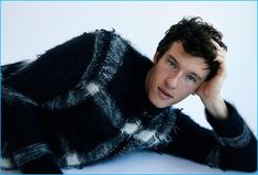 Callum Turner pictured in a Burberry sweater for his W magazine photo shoot.