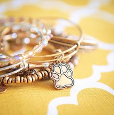 ALEX AND ANI Prints Of Love Charm Bangle | Animals hold an important place in our natural world, in our culture, and most importantly, in our homes. Loyal, intelligent companions that give affection freely, animals lift our spirits and enhance our lives. Embrace your essential role as a caretaker and guardian of Earth's creatures. Share your love openly and take action to make a life-changing difference for animals across America with the Prints of Love Charm. | Companionship • Love •…
