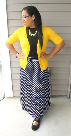 black and white striped maxi skirt with black top and bright yellow cardigan modest summer outfit idea